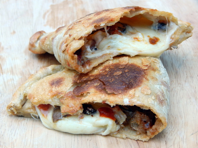 I learned to appreciate calzones and empanadas by baking pizzas at home. If you love deep toppings and excessive cheese, you'll want these recipes. Learn to make Sourdough Calzones and Empanadas.