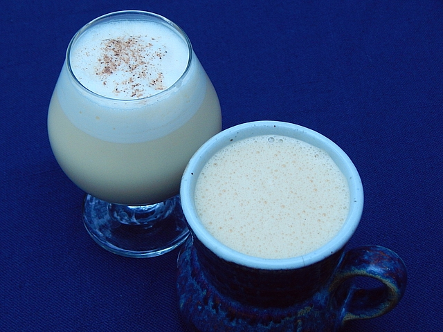 Choose a simple shaken eggnog for a cozy evening in or tom and jerry batter to mix once and pour often. Get cocktail recipes at TwiceasTasty.com.