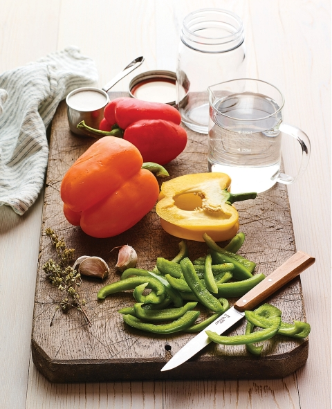 Pickling sweet peppers. Get the recipes in The Complete Guide to Pickling by Julie Laing.